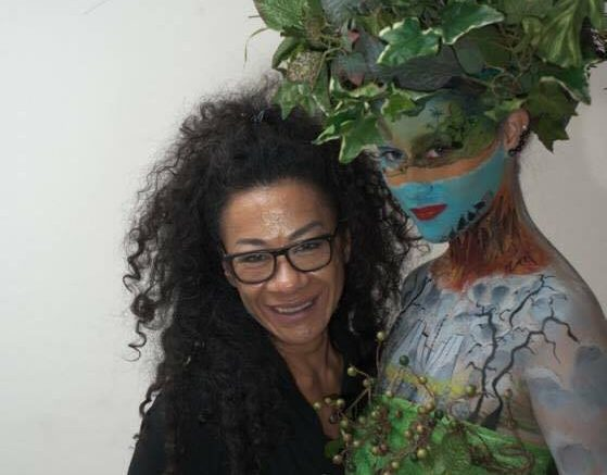 Imelda Perez-Papai with one of her body painting models